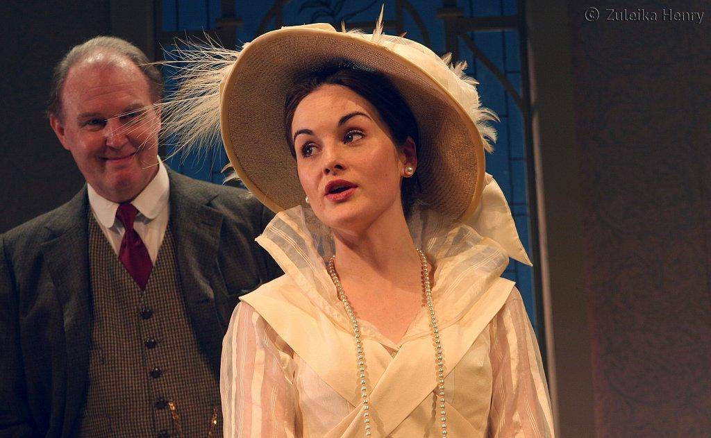 Tim Pigott-Smith as Prof. Higgins and Michelle Dockery as Eliza Doolittle