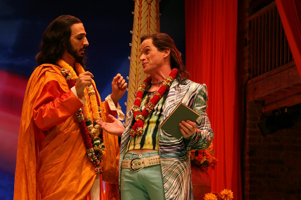 Amir Arison as King Ferdinand of Navarre and Hank Stratton as Berowne
