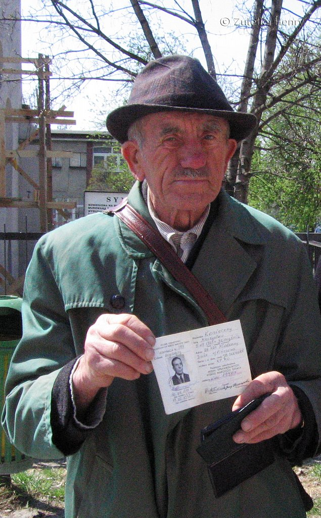 This man is holding his Righteous among the nations ID which was presented to him for helping the Jews escape and risking his own life